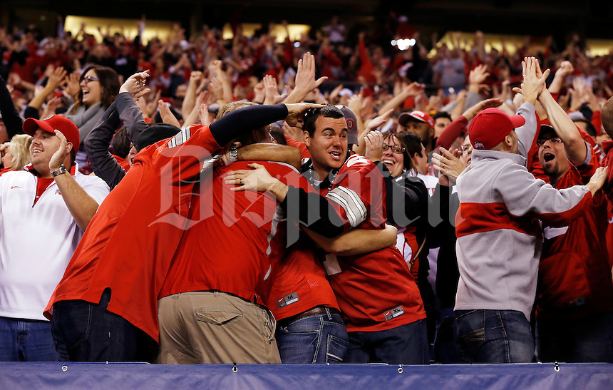 Ohio State fans cheer after a 39-yard touchdown catch by Ohio State Buckeyes wide receiver Devin Smith (9) during the first quarter of the Big Ten Championship game against the Wisconsin Badgers at Lucas Oil Stadium in Indianapolis on Dec. 6, 2014. (Adam Cairns / The Columbus Dispatch)