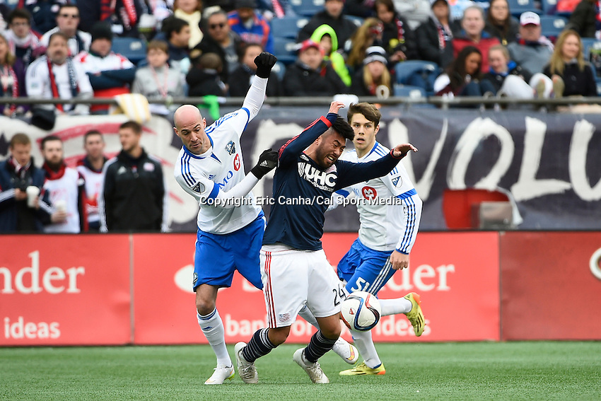 March 21, 2015 - Foxborough, Massachusetts, U.S. - New England Revolution midfielder Lee Nguyen (24) and Montreal Impact defender Laurent Ciman (23) battle for the ball during the MLS game between the Montreal Impact and the New England Revolution held at Gillette Stadium in Foxborough Massachusetts. The Revolution and the Impact ended the game tied 0-0. Eric Canha/CSM