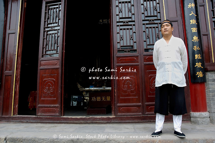 Taoist priest standing outside the Temple of the Eight Immortals (Ba Xian An) monastery in Xi'an, Shaanxi, China.