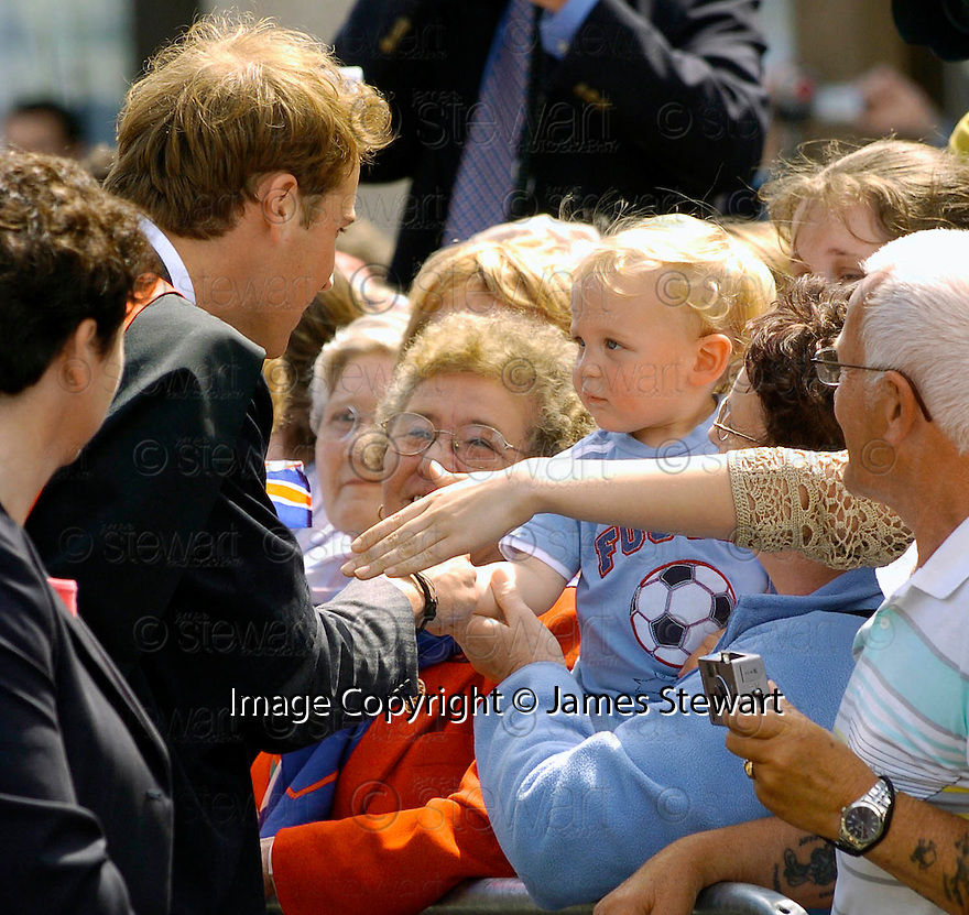 23/06/2005         Copyright Pic : James Stewart.File Name : sct_jspa11 wills graduation.PRINCE WILLIAM MEETS ONE OF THE YOUNGER MEMBERS OF THE CROWD AFTER HIS GRADUATION FROM ST ANDREWS UNIVERSITY......Payments to :.James Stewart Photo Agency 19 Carronlea Drive, Falkirk. FK2 8DN      Vat Reg No. 607 6932 25.Office     : +44 (0)1324 570906     .Mobile   : +44 (0)7721 416997.Fax         : +44 (0)1324 570906.E-mail  :  jim@jspa.co.uk.If you require further information then contact Jim Stewart on any of the numbers above.........