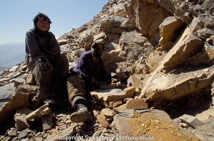 A miner and is assistant prepare the explosive to be use to blow up the heavy Emeralds rock at 4000 meters high, in the Panshir valley.