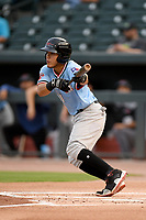 Second baseman Frainyer Chavez (11) of the Hickory Crawdads bats in a game against the Columbia Fireflies on Tuesday, August 27, 2019, at Segra Park in Columbia, South Carolina. Columbia won, 3-2. (Tom Priddy/Four Seam Images)