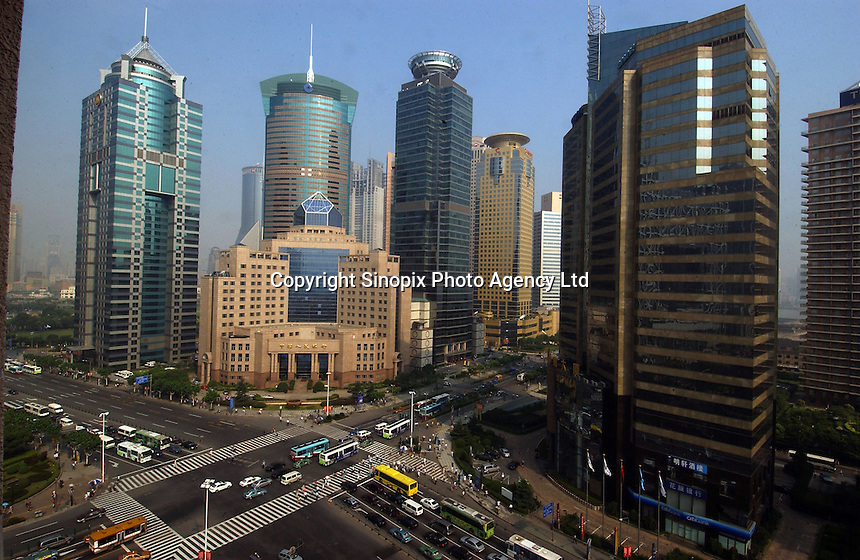 Modern buildings and a traffic crossroads in the Pudong area of Shanghai, China. The Pudong area is the newly developed commercial district of Shanghai and is home to some of China's most modern buildings..