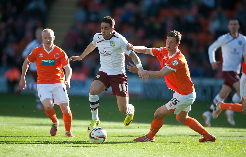 Burnley's Danny Ings gets away from Blackpool's Harrison McGahey<br /> <br /> Photo by Stephen White/CameraSport<br /> <br /> Football - The Football League Sky Bet Championship - Blackpool v Burnley - Friday 18th April 2014 - Bloomfield Road - Blackpool<br /> <br /> &copy; CameraSport - 43 Linden Ave. Countesthorpe. Leicester. England. LE8 5PG - Tel: +44 (0) 116 277 4147 - admin@camerasport.com - www.camerasport.com