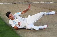 Trent Boult falls over after bowling.<br /> New Zealand Blackcaps v England. 1st day/night test match. Eden Park, Auckland, New Zealand. Day 4, Sunday 25 March 2018. &copy; Copyright Photo: Andrew Cornaga / www.Photosport.nz
