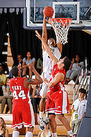28 January 2012:  FIU guard-forward Dominique Ferguson (3), on the receiving end of an alley-oop, puts up a basket over WKU guard-forward Vinny Zollo (41) and guard-forward George Fant (44) in the first half as the Western Kentucky University Hilltoppers defeated the FIU Golden Panthers, 61-51, at the U.S. Century Bank Arena in Miami, Florida.