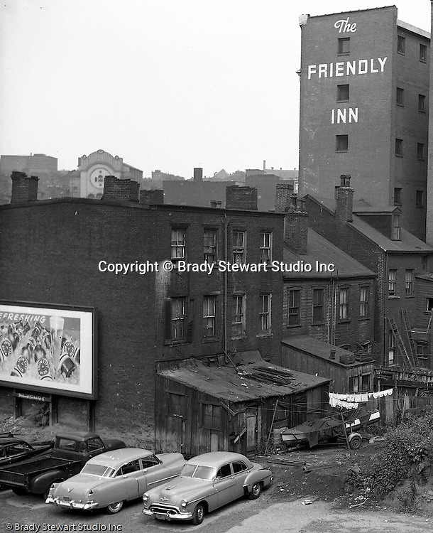 Pittsburgh PA:  View of Friendly Inn on Forbes Avenue from Magee Street in the uptown section of Pittsburgh near Duquesne University - 1950.  Assignment was for a developer trying to get some of the buildings condemned so he could get them at a good price for future development.