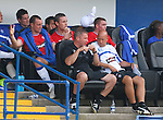 Kris Boyd and David Weir relax on the subs bench with Ally McCoist and Kenny McDowall