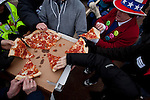 Ian's Pizza distributes pizzas donated to protestors at the State Capitol in Madison, WI, February 23, 2011.