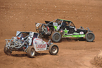 Apr 17, 2011; Surprise, AZ USA; LOORRS driver Curt Geer (385) leads Greg Crew (337) during round 4 at Speedworld Off Road Park. Mandatory Credit: Mark J. Rebilas-