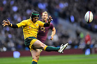 Twickenham, England. Berrick Barnes of Australia in action during the QBE international match between England and Australia for the Cook Cup at Twickenham Stadium on November 10, 2012 in Twickenham, England Photo Michael Paler/ Photosport.co.nz