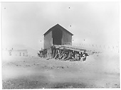 An unloading shed or coaling trestle with an inclined ramp.<br /> C&amp;S  Como, CO