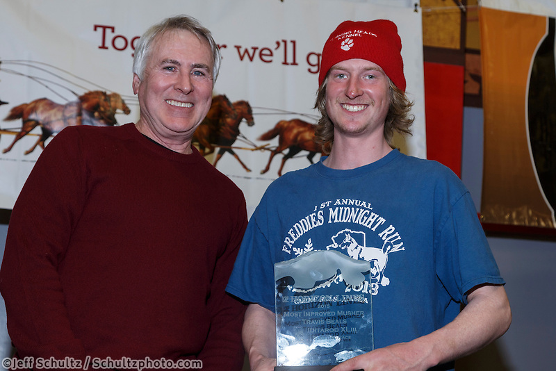 Travis Beals (R)  recieves the Horizon Lines Most Improved musher award from John Schweiken at the finishers banquet in Nome on Sunday  March 22, 2015 during Iditarod 2015.  <br /> <br /> (C) Jeff Schultz/SchultzPhoto.com - ALL RIGHTS RESERVED<br />  DUPLICATION  PROHIBITED  WITHOUT  PERMISSION