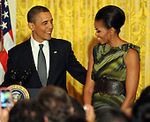 "United States President Barack Obama puts his arm around First Lady Michelle Obama after joking with her during a Cinco de Mayo reception in the East Room of the White House in Washington, DC, on Thursday, May 5, 2011. Obama said ""You do not want to be between Michelle and a tamale.""   .Credit: Roger L. Wollenberg / Pool via CNP"