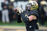 Alex Bachman (17) of the Wake Forest Demon Deacons catches a pass in warm-ups prior to the game against the Louisville Cardinals at BB&T Field on October 28, 2017 in Winston-Salem, North Carolina.  The Demon Deacons defeated the Cardinals 42-32.  (Brian Westerholt/Sports On Film)