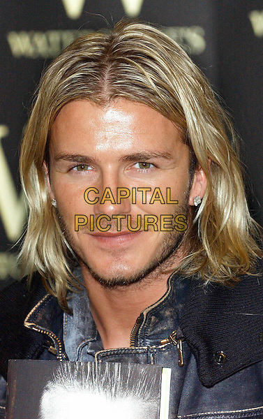"DAVID BECKHAM.at Waterstones, Piccadilly for booksigning of autobiography ""My Side"".portrait headshot earrings, long blonde hair, stubble.17/11/2003.www.capitalpictures.com.sales@capitalpictures.com.©Capital Pictures"