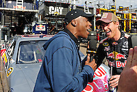 Nov. 13, 2009; Avondale, AZ, USA; Television personality Arsenio Hall (left) talks with NASCAR Sprint Cup Series driver Scott Speed during practice for the Checker O'Reilly Auto Parts 500 at Phoenix International Raceway. Mandatory Credit: Mark J. Rebilas-