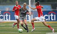 Philadelphia defender, Allison Falk (3) cuts the ball inside as Washington defender, Alex Singer (21) approaches.  After trailing the Washington Freedom, 2-0, at the half, Philadelphia scored a stunning come-from-behind victory, 3-2 at John A Farrell Stadium in West Chester, PA.