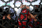 A Palestinian girl looks through the gate of Rafah border crossing during a rally calling on Egyptian authorities to open the crossing, in Rafah in the southern Gaza Strip December 22, 2015. Egypt has kept its Rafah crossing largely shut since Cairo's Islamist president was toppled by the army in 2013. Since then, it opened the crossing partially and on a few occasions to allow thousands of Palestinians to travel in and out of the Gaza Strip, border officials said. Photo by Abed Rahim Khatib