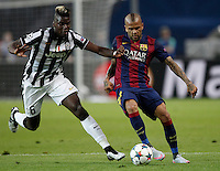 Calcio, finale di Champions League Juventus vs Barcellona all'Olympiastadion di Berlino, 6 giugno 2015.<br /> Juventus' Paul Pogba, left, and FC Barcelona's Daniel Alves fight for the ball during the Champions League football final between Juventus Turin and FC Barcelona, at Berlin's Olympiastadion, 6 June 2015.<br /> UPDATE IMAGES PRESS/Isabella Bonotto