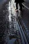 Man crosses muddy tram rails on Leidsestraat, Amsterdam, December 2010
