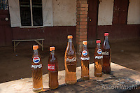 N. Uganda, Kitgum District. Gasoline for sake in soda bottles.