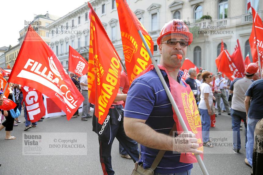 - general strike called by the CGIL laborunion  against the government's economic law, demonstration in Milan<br /> <br /> - sciopero generale indetto dal sindacato CGIL contro la manovra economica del governo; manifestazione di Milano
