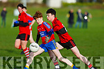 ISK's Kieran Dennehy heading goal bound under pressure from Bishopstown's Brian Lynch in the Frewen Cup in Currans on Friday.