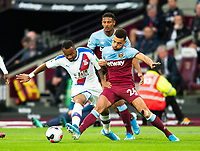 Crystal Palace Jordan Ayew and West Ham United Ryan Fredericks during the Premier League match between West Ham United and Crystal Palace at the Olympic Park, London, England on 5 October 2019. Photo by Andrew Aleksiejczuk / PRiME Media Images.