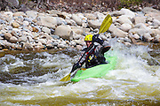 Kayaking the East Branch of the Pemigewasset River in Lincoln, New Hampshire USA during the spring months