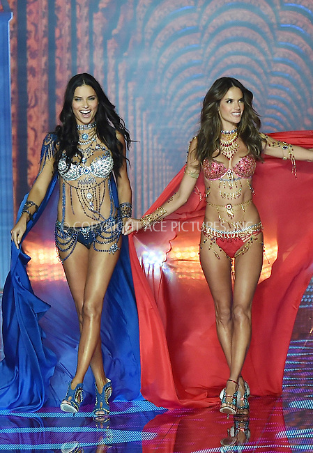 WWW.ACEPIXS.COM<br /> <br /> December 2 2014, London<br /> <br /> Adriana Lima and Alessandra Ambrosio wear the Fantasy Bras as they walk the runway during the Victoria's Secret show at Earls Court on December 2 2014 in London<br /> <br /> By Line: Hugo Philpott/ACE Pictures<br /> <br /> ACE Pictures, Inc.<br /> tel: 646 769 0430<br /> Email: info@acepixs.com<br /> www.acepixs.com