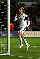 Pictured: Michu of Swansea (L) celebrating his equaliser, making the score 2-2. Monday 16 September 2013<br />