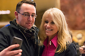 Trump campaign manager Kellyanne Conway is seen in the lobby of Trump Tower, posing for selfies with visitors while responding to questions posed by members of the press, in New York, NY, USA on December 16, 2016. <br /> Credit: Albin Lohr-Jones / Pool via CNP