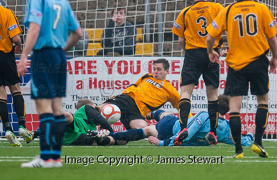 Alloa keeper Scott Bain and Alloa's Jason Marr combine to stop Forfar's Chris Templeman's shot on the line.