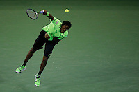Gael Monfils of France serves to Roger Federer of Switzerland during their quarter-final game at the US Open 2014 tennis tournament at the USTA Billie Jean King National Center in New York.  09.04.2014. VIEWpress