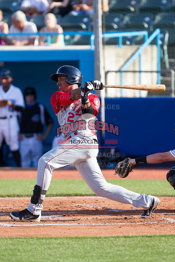 Michael Bernal (27) of the Brooklyn Cyclones follows through on his swing against the Hudson Valley Renegades at Dutchess Stadium on June 18, 2014 in Wappingers Falls, New York.  The Cyclones defeated the Renegades 4-3 in 10 innings.  (Brian Westerholt/Four Seam Images)