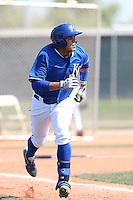Francisco Pena #26 of the Kansas City Royals runs to first base during a Minor League Spring Training Game against the San Diego Padres at the Kansas City Royals Spring Training Complex on March 26, 2014 in Surprise, Arizona. (Larry Goren/Four Seam Images)