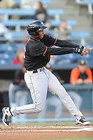 Delmarva Shorebirds Jonathan Schoop #46 swings at a pitch during  a game against  the  Asheville Tourists at McCormick Field in Asheville,  North Carolina;  May 6, 2011. The Shorebirds won the game 6-5.  Photo By Tony Farlow/Four Seam Images