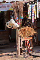 Myanmar, Burma.  Soccer Balls and Brooms for Sale, Streetside Shop,  Inle Lake Village, Shan State.
