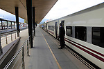 Train awaiting departure on platform at railway station, Algeciras, Cadiz province, Spain