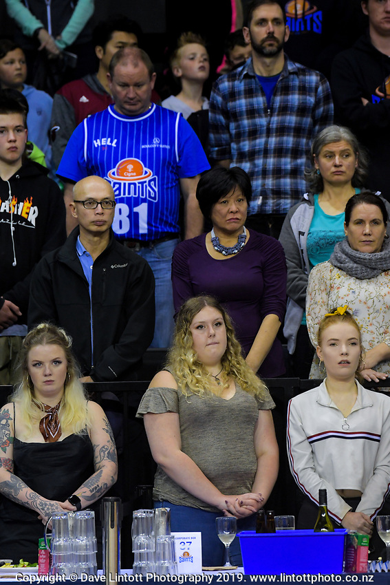 Fans stand in silence to observe ANZAC Day before the National Basketball League match between Cigna Wellington Saints and Southland Sharks at TSB Bank Arena in Wellington, New Zealand on Thursday, 25 April 2019. Photo: Dave Lintott / lintottphoto.co.nz