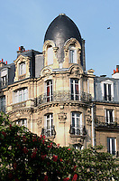 Apartment block in Paris with high windows and domed roof in the spring. Paris, France.