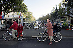 AMSTERDAM - NETHERLANDS - 19 OCTOBER 2004 -- Bicycles are famously the most popular mean of transportation in the city. A family with the children sitting on the back on a bike-ride crossind a bridge of the canal of the Prinsengracht.-- PHOTO:  EUP-IMAGES / JUHA ROININEN