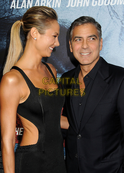 Stacy Keibler, George Clooney.'Argo' Los Angeles premiere held at the AMPAS Samuel Goldwyn Theater, Beverly Hills, California USA, .4th October 2012..half length couple black suit dress cut out sides away tall short ponytail .CAP/ADM/BP.©Byron Purvis/AdMedia/Capital Pictures.