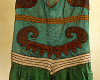 The bodice of one of the costumes, its panels of silk outlined in bronze coloured beads