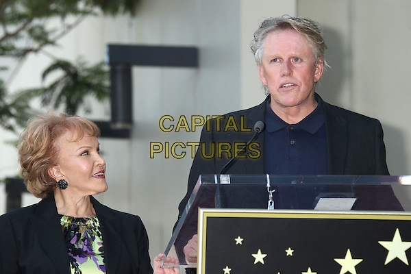 "Maria Elena Holly & Gary Busey .Buddy Holly posthumous STAR Induction into ""The Hollywood Walk of Fame"" on his 75th Birthday held in front of the Capital Records Building on Vine Street, Hollywood, California, USA..September 7th, 2011.half length black jacket blue top profile floral print green profile podium speech.CAP/ADM/RE.©Russ Elliot/AdMedia/Capital Pictures."