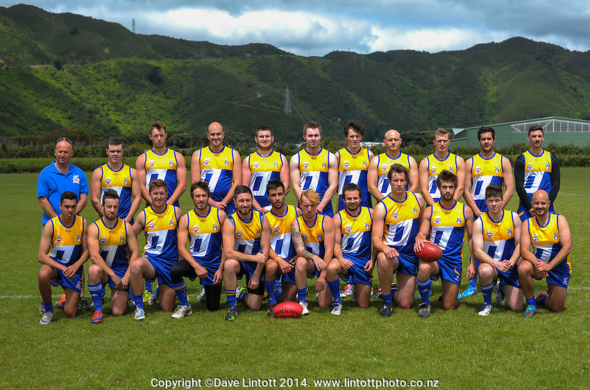 The Otago Riot team pose for a team photo before the Wellington Australian Rules Football National Provincial Championship final match between the Canterbury Cobras (black and red) and Otago Riot (blue and gold) at Hutt Park, Wellington, New Zealand on Saturday, 6 December 2014. Photo: Dave Lintott / lintottphoto.co.nz