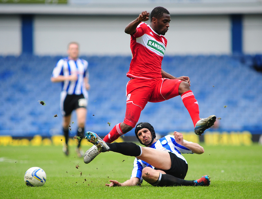 Middlesbrough's Mustapha Carayol is tackled by Sheffield Wednesday's Miguel Angel Llera .. - (Photo by Chris Vaughan/CameraSport) - ..Football - npower Football League Championship - Sheffield Wednesday v Middlesbrough - Saturday 4th May 2013 - Hillsborough - Sheffield..© CameraSport - 43 Linden Ave. Countesthorpe. Leicester. England. LE8 5PG - Tel: +44 (0) 116 277 4147 - admin@camerasport.com - www.camerasport.com