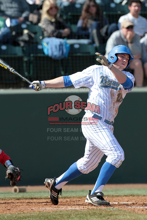 Cody Regis #18 of the UCLA Bruins bats against the Maryland Terrapins at Jackie Robinson Stadium on February 19, 2012 in Los Angeles,California. Maryland defeated UCLA 5-1.(Larry Goren/Four Seam Images)