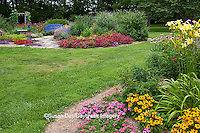 63821-21807 Island flower beds with blue bench, trellis, and stone path. Pink &  Homestead Purple Verbena (Verbena canadensis), Red Verbena, New Gold Lantana (Lantana camara) Butterfly Bushes, Zinnias, Tiger Eye Black-eyed Susans (Rudbeckia hirta) Yellow Daylily (Hemerocallis) Red Spread Lantana, Pink Wave Petunias, Marion Co., IL